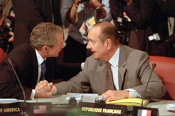 President Bush and President Chirac of France talk over issues during the G-8 sessions, July 21, 2001. White House photo by Paul Morse.