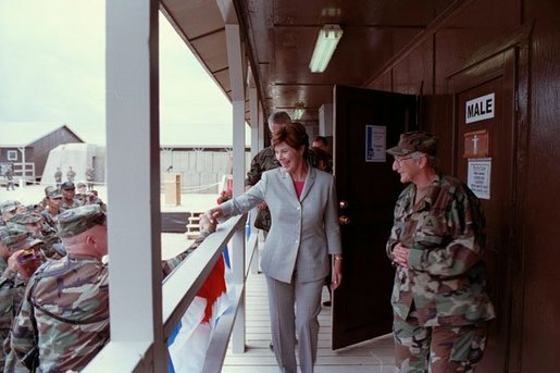 Laura Bush attends the Dedication of the Laura Bush Center for Education at Camp Bondsteel July 24, 2001 in Kosovo, Federal Republic of Yugoslavia. White House photo by Moreen Ishikawa.
