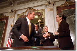 President Bush greets Nancy Coverdell after signing in honor of her husband, Paul Coverdell, a former director of the Peace Corps, Thursday, July 26, 2001.