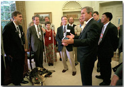 President Bush meets with Erik Weihenmeyer (far left), 32, of Golden, Colorado, and his friends to the Oval Office July 26, 2001. Mr. Weihenmeyer was the first blind person to reach the summit of Mount Everest May 25, 2001. After losing his sight to retinoscheses at the age of 13, he began rock climbing at the age of 16. White House photo by Paul Morse.