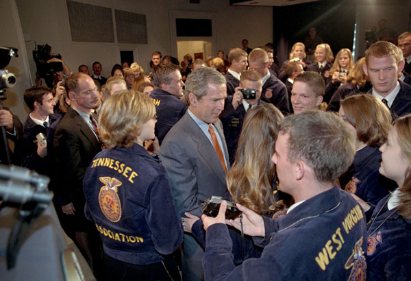 Tilling it up with members of Future Farmers of America, President Bush wades into an enthusiastic crowd after addressing 100 representatives the Friday, July 27, 2001. White House photo by Eric Draper.
