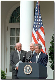 President Bush, former President Jimmy Carter and House Minority Leader Bob Michel hold a press conference addressing election reform principles in the Rose Garden July 31, 2001. White House photo by Eric Draper.