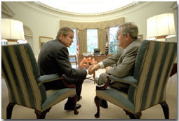 President Bush and Representative Charles Norwood seal their negotiations over the Patient's Bill of Rights in the Oval Office late afternoon Wednesday August 1, 2001. Shortly thereafter, the President and Rep. Norwood gave a press briefing announcing their agreement. White House photo by Eric Draper.