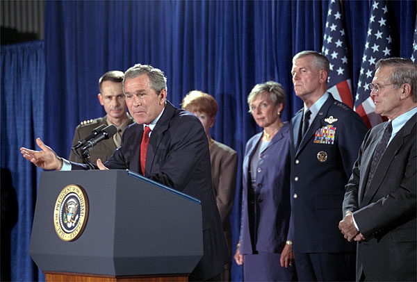 With Secretary of Defense, Donald Rumsfeld by his side, President Bush announces that General Richard B. Myers, center, will be the Chairman of the Joint Chiefs and General Pete Pac, far left, will serve as Vice Chairman of the Joint Chiefs during a press briefing at the Crawford Community Center, Aug. 24. White House photo by Moreen Ishikawa.
