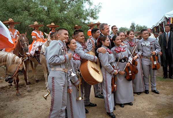 President Bush poses for photos with a mariachi band during the dedication ceremony of the San Antonio Missions National Historical Park in San Antonio, Texas, Aug. 29. White House photo by Moreen Ishikawa.