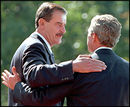 President Fox and President Bush greet each other at the State Arrival Ceremony.