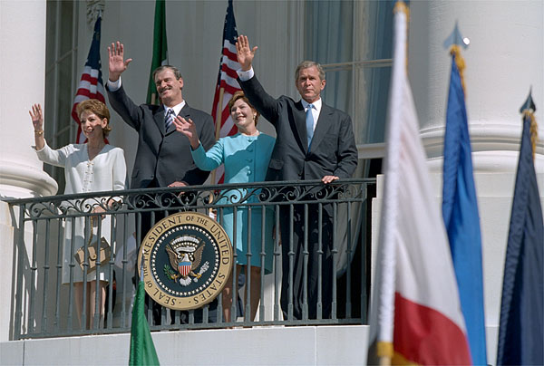 Waving from the White House balcony, President Bush welcomes Mexican President Vicente Fox during the President's First State Visit Sept. 6. White House Photo by David Bohrer.