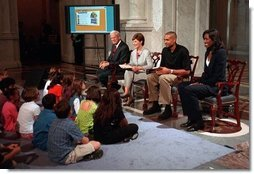 Librarian of Congress, James Billington, Mrs. Bush, Orlando Magic Grant Hill and LA Sparks Lisa Leslie participate in the National Book Festival Back to School event in the Great Hall at the Library of Congress Jefferson Building Sept. 7, 2001 in Washington, D.C.  White House photo by Moreen Ishikawa