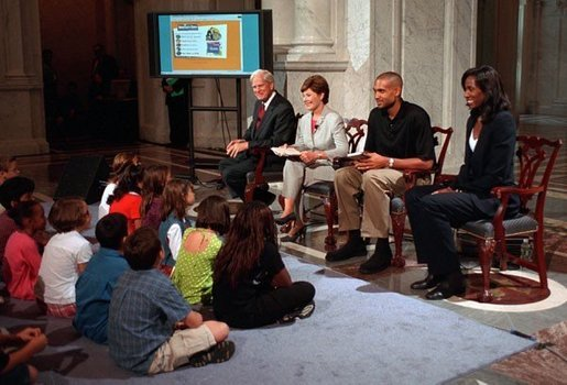 Librarian of Congress, James Billington, Mrs. Bush, Orlando Magic Grant Hill and LA Sparks Lisa Leslie participate in the National Book Festival Back to School event in the Great Hall at the Library of Congress Jefferson Building Sept. 7, 2001 in Washington, D.C. White House photo by Moreen Ishikawa.