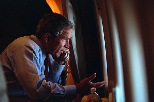 After departing Offutt Air Force Base in Nebraska, President George W. Bush confers with Vice President Dick Cheney from Air Force One during his flight to Andrews Air Force Base Sept. 11, 2001. White House photo by Eric Draper
