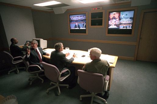 President George W. Bush, White House Chief of Staff Andy Card (left) and Admiral Richard Mies conduct a video tele-conference at Offutt Air Force Base in Nebraska, Sept. 11, 2001. White House photo by Eric Draper
