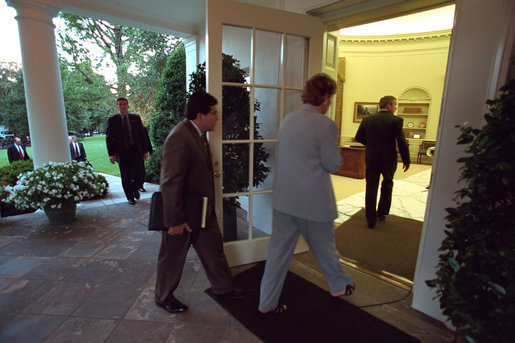 President George W. Bush returns to the White House followed by White House Counsel Alberto Gonzales and Counselor Karen Hughes Sept. 11, 2001. White House photo by Eric Draper