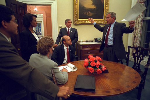 Returning from Sarasota, Fla., where he first saw news footage of the attack, President George W. Bush immediately gathers his senior staff in the private dining room off the Oval Office Sept. 11, 2001. Meeting with the President from left to right are White House Counsel Alberto Gonzales, Counselor Karen Hughes, National Security Advisor Dr. Condoleezza Rice, Press Secretary Ari Fleischer and Chief of Staff Andy Card. White House photo by Eric Draper