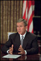 President George W. Bush addresses the nation from the Oval Office the evening of Sept. 11, 2001. White House photo by Eric Draper
