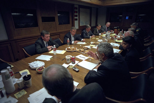 After addressing the nation, President George W. Bush meets with his National Security Council in the Presidential Emergency Operations Center Sept. 11, 2001. White House photo by Eric Draper