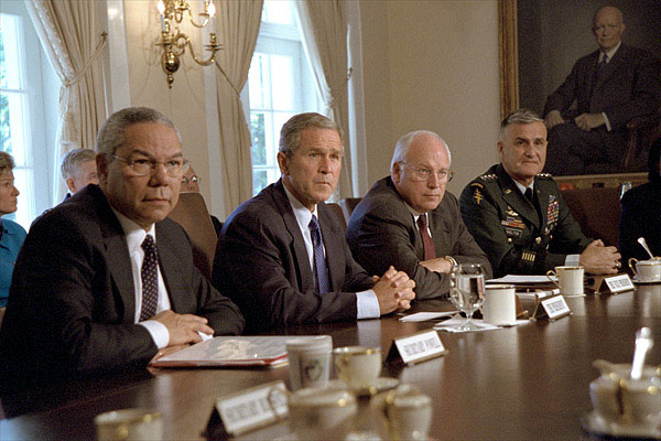Accompanied by Secretary of State Colin Powell, far left, Vice President Dick Cheney and Chairman of the Joint Chiefs of Staff Hugh Shelton (far right), President George W. Bush talks with the press about the previous day's terrorist attacks during a cabinet meeting Sept. 12, 2001. White House photo by Tina Hager.