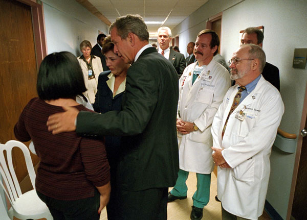 President George W. Bush and First Lady Laura Bush comfort a family member of a victim of the Pentagon terrorist attack during a visit to Washington Hospital Center, Thursday, Sept. 13, 2001. White House Photo by Eric Draper.