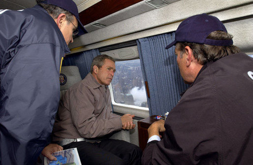President George W. Bush tours the World Trade Center disaster site aboard Marine One with New York Mayor Rudolph Giuliani, left, and New York Governor George Pataki, Friday, Sept. 14, 2001. White House photo by Eric Draper