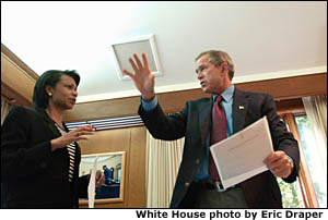 President George W. Bush meets with National Security Advisor Condoleezza Rice inside his office at Camp David, Sunday morning, Sept. 16, 2001. White House photo by Eric Draper.
