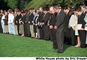 President George Bush and Vice President Dick Cheney lead the White House staff in a moment of silence on the South Lawn Tuesday morning, Sept. 18, 2001. White House photo by Eric Draper.