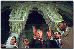 "After addressing the media, President George Bush talks with his hosts during his visit to the Islamic Center of Washington, D.C. Sept. 17, 2001. ""And it is my honor to be meeting with leaders who feel just the same way I do. They're outraged, they're sad,"" said the President during his remarks. ""They love America just as much as I do."". White House photo by Eric Draper."