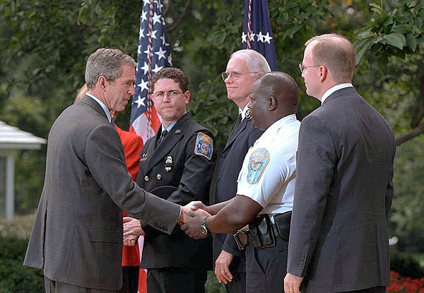 "Inviting several charitable organizations to the White House Rose Garden, President Bush thanks representatives from the groups that helped with the relief effort at the World Trade Center and the Pentagon. ""Last week was a really horrible week for America. But out of our tears and sadness, we saw the best of America as well. We saw a great country rise up to help,"" said the President in his remarks. More than 55 million dollars has been raised in one week. White House photo by Paul Morse."