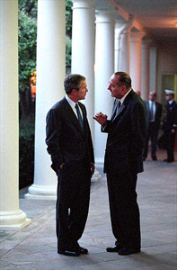 Walking along the West Wing Colonnade, President Bush and French President Jacque Chirac discuss current matters Sept. 18. White House photo by Paul Morse.