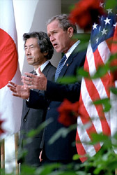 President Bush and Japanese Prime Minister make a joint statement pledging to support each other in the fight against global terrorism during press conference in the Rose Garden Sept. 25. White House photo by Tina Hager.