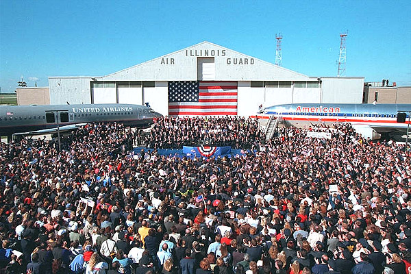 "Airline employees crowd together on the tarmac at Chicago's O'Hare International Airport to meet President Bush and honor their industry colleagues Sept. 27. ""I think it's interesting that on one side, we see American; on the other side, it says United,"" said the President in his remarks. ""Because that's what we are -- America is united."". White House photo by Paul Morse."