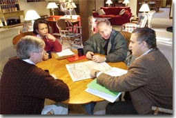 President George W. Bush receives a briefing during a meeting with CIA Director George Tenent, right, National Security Advisor Condoleezza Rice, and Chief of Staff Andy Card at Camp David, Saturday, Sept. 29, 2001. White House photo by Eric Draper.