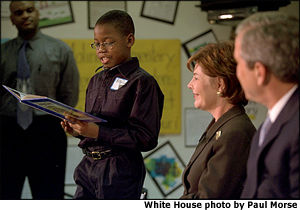 A St. Louis elementary school student reads out loud to President and Mrs. Bush. White House Photo by Paul Morse.