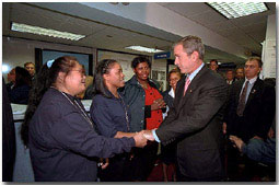 "Federal Emergency Management Agency employees greet President Bush during his visit to the agency's headquarters to thank them for recent days of hard work Oct. 1. ""I'm proud of the work that the FEMA employees all across the country are doing on behalf of America,"" said the President in his remarks. White House photo by Tina Hager."