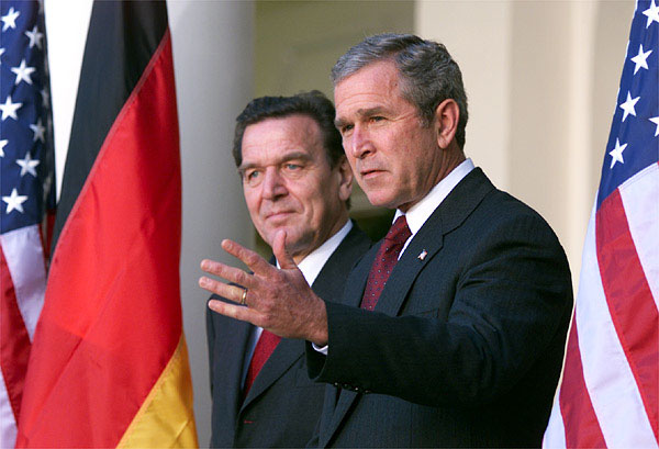 White House photo by Paul Morse. President George Bush and Germany's Chancellor Gerhard Schroeder address the media from the White House steps in the Rose Garden Oct 9.
