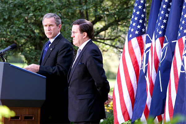 "President Bush and NATO Secretary General Lord Robertson address the media in the Rose Garden Oct. 10. ""(NATO's support after the attacks) was an act of great friendship in a time of great need, and our country will never forget.,"" said the President in his remarks. White House photo by Paul Morse."