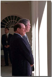 President George Bush and Italy's Prime Minister Silvio Berlusconi talk on the colonnade outside of the Oval Office Oct. 15. White House photo by Tina Hager.