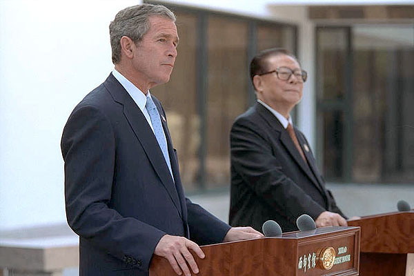 President George W. Bush and Chinese President Jiang Zemin deliver a joint statement to the media in Shanghai, People's Republic of China, Oct. 19. White House photo by Eric Draper.