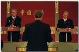 Presidents Bush and Putin hold a joint press conference during the APEC economic summit in Shanghai, China, Oct. 21. White House photo by Tina Hager.