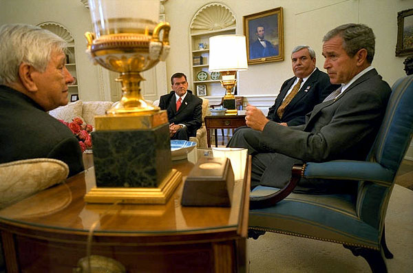 President George W. Bush meets with Director of the Office of Homeland Security Tom Ridge, Postmaster General John Potter, and President of the National Association of Letter Carriers Vince Sombratto in the Oval Office Oct. 22. White House photo by Tina Hager.