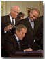 "President George W. Bush signs the Patriot Act, Anti-Terrorism Legislation, in the East Room Oct. 26.  ""With my signature, 