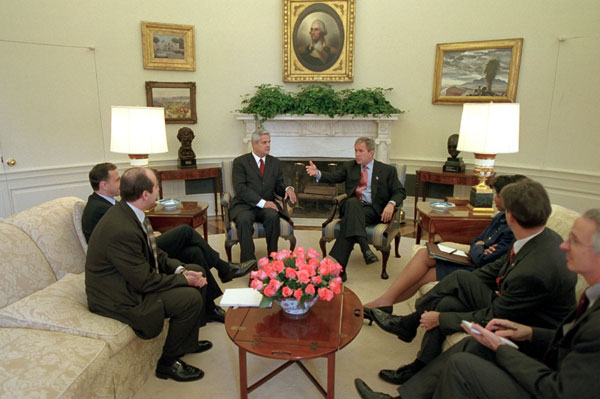 President George W. Bush meets with the Prime Minister of Romania Adrian Nastase in the Oval Office Nov. 1. White House photo by Eric Draper.