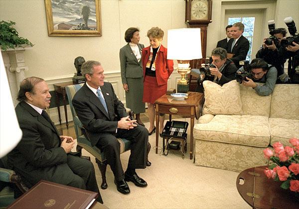 President George W. Bush and Algerian President Abdelaziz Bouteflika talk with the media in the Oval Office Nov. 5. White House photo by Eric Draper.