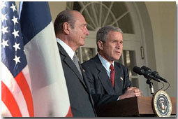 President George W. Bush and French President Jacque Chirac address the media in the Rose Garden Nov. 6. White House photo by Tina Hager.