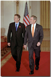 "President George W. Bush and Prime Minister Tony Blair of England walk out to address the media in Cross Hall at the White House Nov. 7. ""We've got no better friend in the world than Great Britain,"" said the President during his remarks. White House photo by Paul Morse."