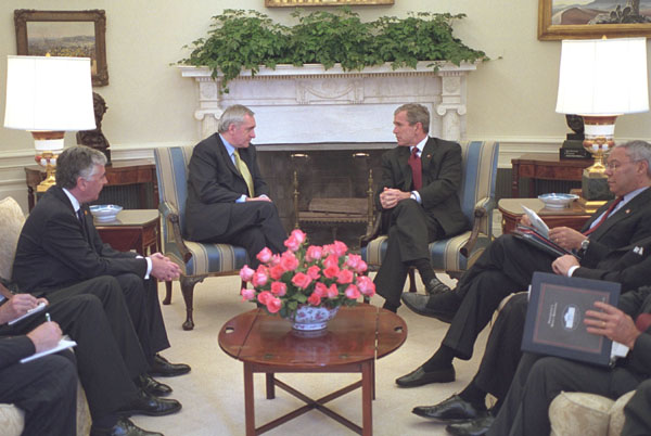 President George W. Bush talks with Prime Minister Bertie Ahern of Ireland in the Oval Office Nov. 8. White House photo by Tina Hager.