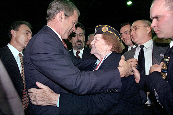 Attending the Veterans Day Prayer Breakfast at Park Avenue Seventh Regiment Armory in New York Nov. 11, President George W. Bush embraces Arlene Howard, who gave President Bush the badge from her son, George Howard, a Port Authority police officer who died at the World Trade Center. White House photo by Paul Morse.