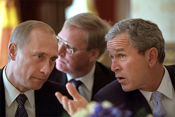 "President George W. Bush talks with Russian President Vladimir Putin during a working lunch in the Blue Room at the White House Nov. 13. Following their meetings at the White House, the two Presidents are meeting again at President Bush's ranch in Crawford, Texas. ""He'll also get a taste of rural life here in Texas,"" said the President of the Russian leader's visit. ""He'll get to see Houston, and he's also going to get to come to Crawford."". White House photo by Eric Draper."