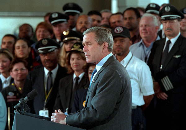 "President George W. Bush addresses the audience at the Signing of Aviation Security Legislation at Ronald Reagan National Airport Nov. 19. in Washington, D. C. ""The broad support for this bill shows that our country is united in this crisis,"" said the President."" We have our political differences, but we're united to defend our country. And we're united to protect our people."". White House photo by Paul Morse."