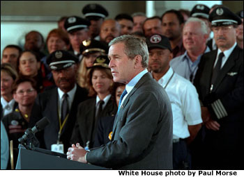 "President <a href=""/news/releases/2001/11/20011119-2.html"">George W. Bush</a> addresses the audience at the Signing of Aviation Security Legislation at Ronald Reagan National Airport Nov. 19. in Washington, D. C. ""The broad support for this bill shows that our country is united in this crisis,"" said the President."" We have our political differences, but we're united to defend our country. And we're united to protect our people."". White House photo by Paul Morse."