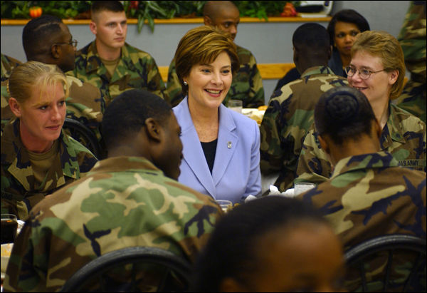 "Laura Bush talks with members of the 101st Airborne at Fort Campbell, Kentucky. Known as ""The Screaming Eagles,"" this airborne division took part in the largest airborne assault of World War II and also served in Vietnam and more recently in the Balkans. White House photo by Tina Hager."