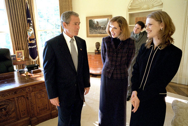"President George W. Bush talks with Dayna Curry, center, and Heather Mercer in the Oval Office Nov. 26. The two humanitarian workers recently returned to the United States after being held captive by the Taliban regime for three months. ""Heather Mercer and Dayna Curry decided to go to help people who needed help,"" said the President in his remarks to the media. ""Their faith led them to Afghanistan. One woman who knows them best put it this way: they had a calling to serve the poorest of the poor, and Afghanistan is where that calling took them."". White House photo by Eric Draper."